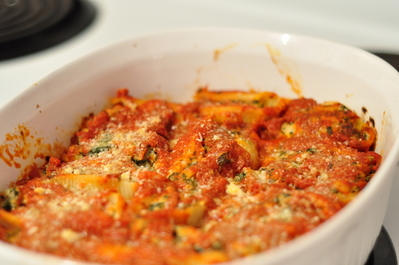 Stuffed pasta shells still in the baking dish