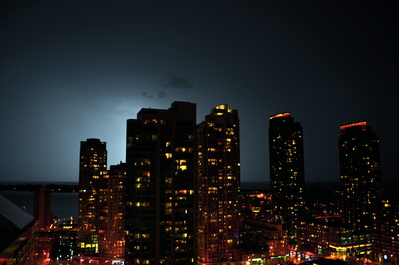 Lightning behind the buildings