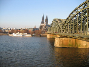 Train bridge and the Kolner Dom in Koln
