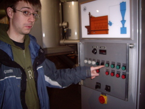 Me pressing a button at the chocolate factory